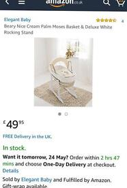 Cream Moses basket with white rocking stand