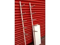 White shelving with metal brackets