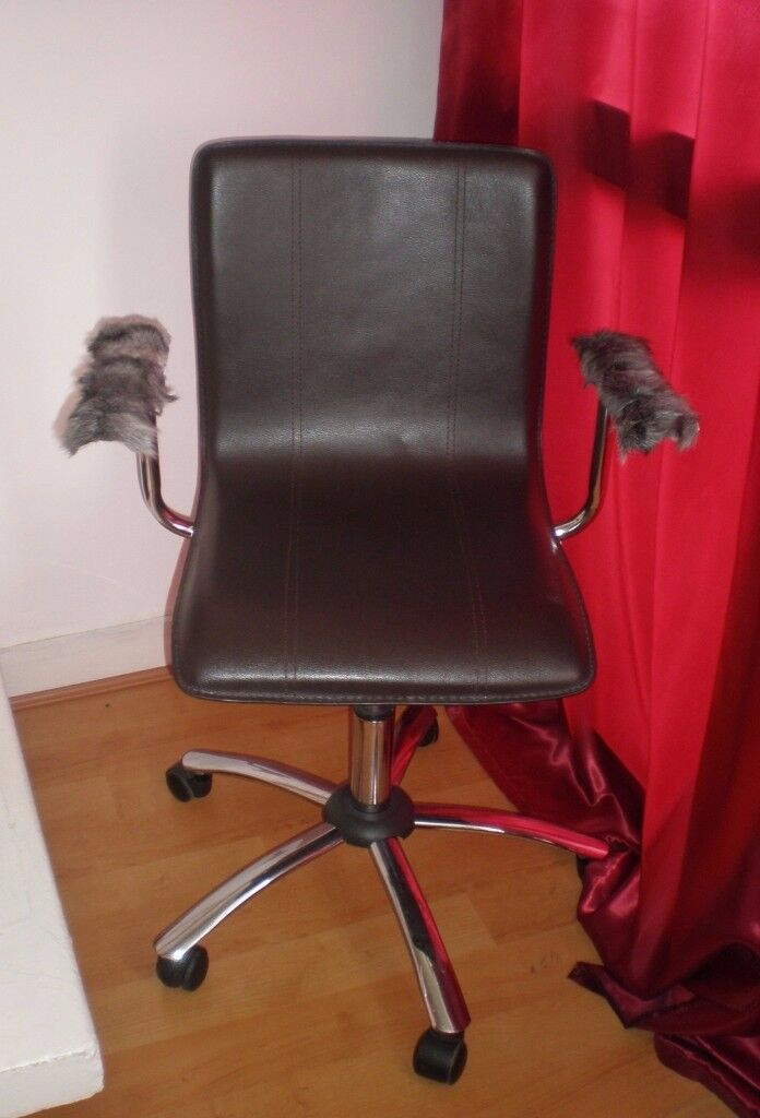 Designer Swivel Chair on Castors with real fur armrests