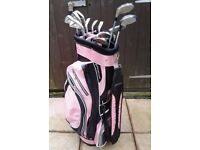 GOLF BAG WITH SET OF 9 CAVITY SOLE GOLF CLUBS IRONS A PUTTER & 2 DRIVERS.