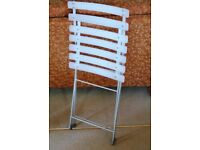 White folding plastic chair