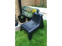 Black IKEA plastic garden chair