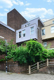 Large 4 bedroom with 2 bathroom arranged over three floors and large private garden in Islington N1