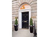 This stately Georgian townhouse retains both exterior and interior features and well maintained.