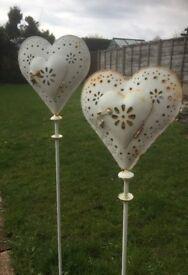 Two White Heart shaped metal tea light holder stakes