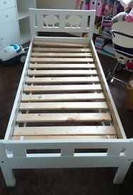 Ikea kritter toddler bed and mattress with removable side safety bar.