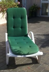 two sun loungers with cushions.