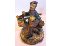 Antique very decorative Capodimonte Painter man sitting on bench figurine