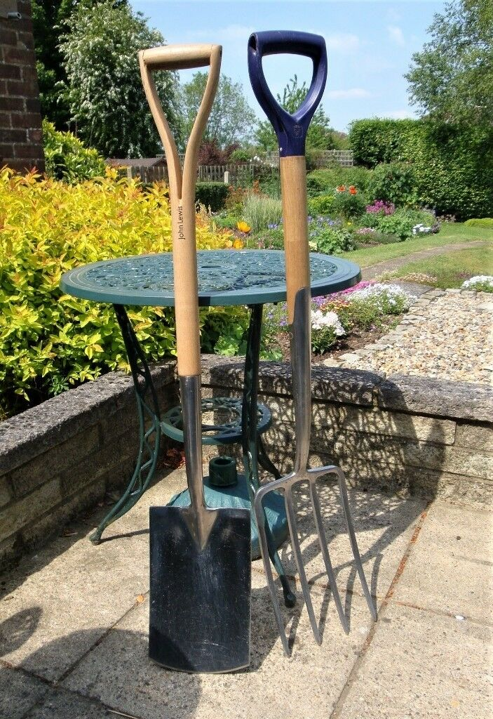 Garden fork and spade, standard size, in stainless steel. Excellent condition.