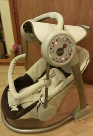 Mamas&papas baby swing with timer few difrent melodies and star lights!good used condition!