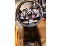 FOR PS3: Logitech Driving Force GT Wheel and Pedal Kit - plus matching stand.