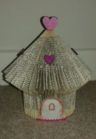 Book crafted fairy house.