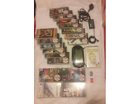 PSP as New, case, charger, 8GB & 2GB memor ycards, with 18 games all perfect condition