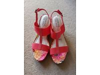 Never worn in immaculate condition gorgeous coral colour wedges ideal for summer size 7