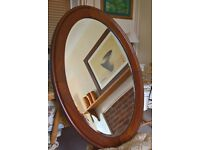 Authentic Victorian Mahogony bevelled glass oval mirror