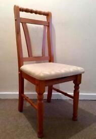 Three cream and pine chairs