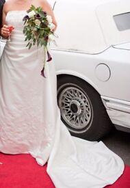 "A True Bride ""Duchess"" ivory wedding dress."