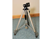 Tripod for still or video camera. Three-section, braced legs. Pan and tilt head.