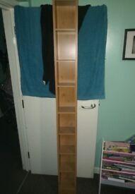 Standing DVD shelf.