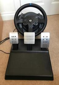 Thrustmaster T300 + T3PA pedals.