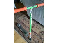 Razor Scooter in green and orange. Includes stunt bars & odi progrip handles.