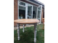 Wooden extendable dinning table and 4 chairs.