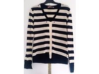 100% wool made-in-Italy black and white striped cardigan. Size S-M. Never been worn.