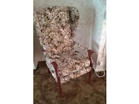 2 High back winged armchairs