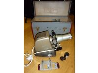 Slide and film roll projector