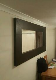 Large dark brown wooden lounge mirror