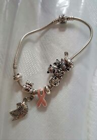 Real Pandora braclet 1 real charm 6 disney and 6 spacers comes with boxes and bag