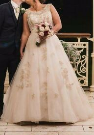 Light cream wedding dress with gold embroidered detailed.
