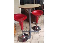 2 Red Bar Stools and Round High Table