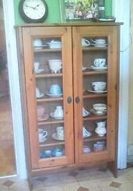 Glass fronted china/CD cabinet.