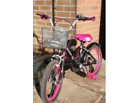 Girls bike with removable stabilisers - (5 to 7 yrs).