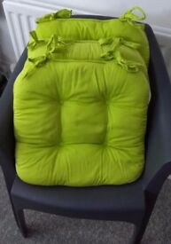Bright green throw and chair cushions