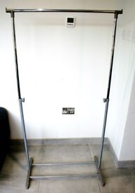 Clothes hanging rail, max hang of 157.5cm, 75cm of hanging rail.
