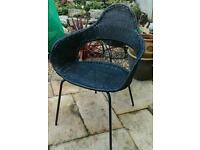 Four black dining chairs