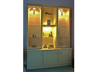 BARGAIN - Lovely wood grain effect display cabinet with interior lights and cupboards with shelves.