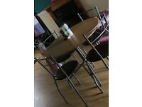 *LIKE NEW* Dining table and 4 chairs for sale
