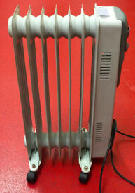 Electric oil filled radiator by Home Heat w/ thermostat & wheels - spares/repairs