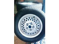 4 unused Sterling Jaguar tyres on pepper pot wheels