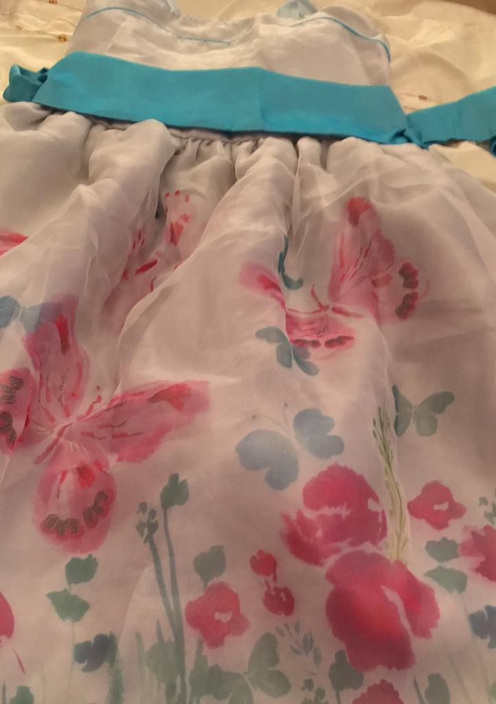 Party dress grey/blue Age 10y5in St Helens, MerseysideGumtree - Girls party/formal dress 10 y blue grey with flowers and butterflies blue waist tie and light blue shoulder straps only worn once in excellent condition smoke free home can deliver within 5 mile free charge or can post out for extra charge