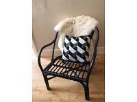 Black wicker rattan armchair. Vintage, retro, industrial style.