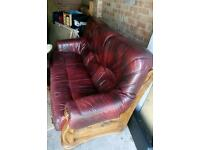 Leather sofa and two armchairs on oak frames £120 o.v.n.o.