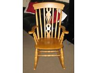 Traditional solid beech fiddleback rocking chair