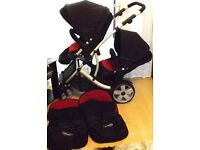 BLACK DOUBLE PRAM ,WITH 2 RED LINERS AND 2 FOOTMUFFS , + RAINCOVER