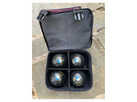 Four bowling balls and bag