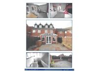 Modern semi detached three story house with garden and garage