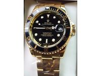 Gold with black face Sunmariner Rolex